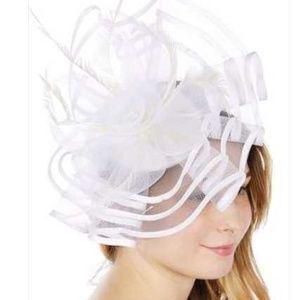 Women's fascinator Hat. Brand new in package